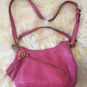 Pink leather Michael Kors purse.